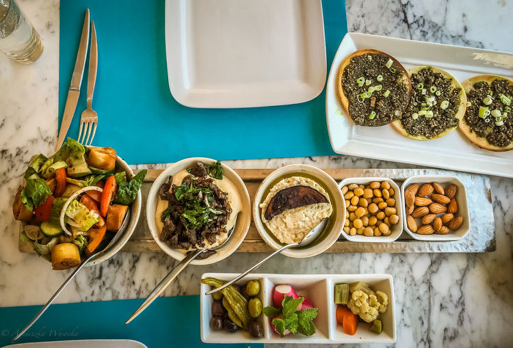 Arabic Food At Its - Meze - Best Arabic Culture Arabic Food Babaghanoush Chickpeas Culture Fattoush Food Food And Drink Food Photography Food Sharing Food Styling Foul  Freshness Hommos Indulgence Lamb Manakish Pickles Ready-to-eat Serving Dish Table Decoration Table Setting Variation Vegetable Zaatar