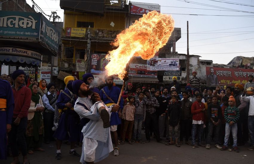 Nihang warriors show their skill on the occasion of Guru Gobind Singh birth anniversary celebration in Allahabad. India Indian Indian Culture  People Watching Skill  Warrior Fire Firework Display Nihang People Real People Sikh Sikhism Sikhlife