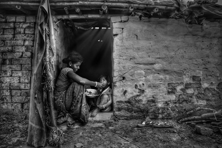 || Real love of poor people || Child Moments Mom With Daughter India Streetphotography Poor  Real People One Person Day Outdoors Full Length Architecture EyeEmNewHere