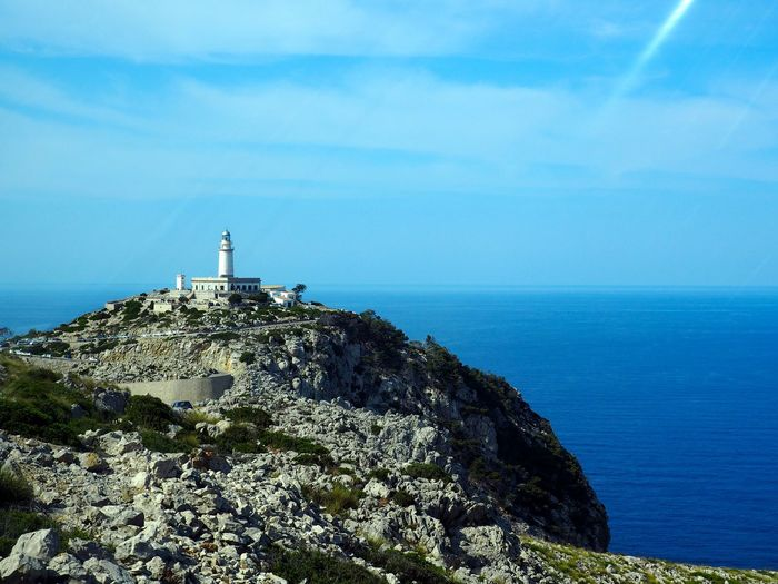 Cap De Formentor Lighthouse On Cliff By Sea