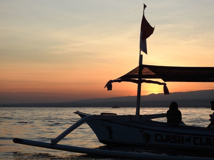 Silhouette Silouette & Sky Sea Sunset Water Flag Nature Sky Beauty In Nature Scenics Transportation Nautical Vessel Horizon Over Water Cloud - Sky Tranquil Scene Outdoors Mode Of Transport Men Tranquility Real People Beach Boat Silhouette Oette Boat Morning Lovina Beach