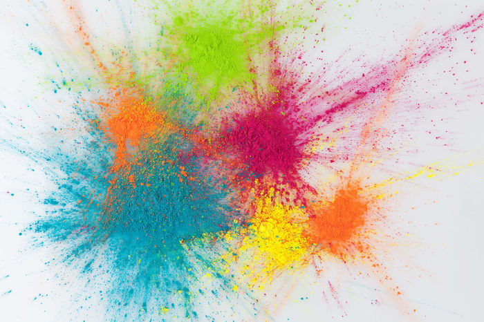 Color explosion concept. Colorful Holi powder exploding on white background Holi Festival Holi Festival Of Colours Abstract Backgrounds Color Explosion Colorful Concept Dye Green Color Holi Holi Powder Multi Colored No People Paint Red Smudged Textured  Top View Vibrant Color Yellow