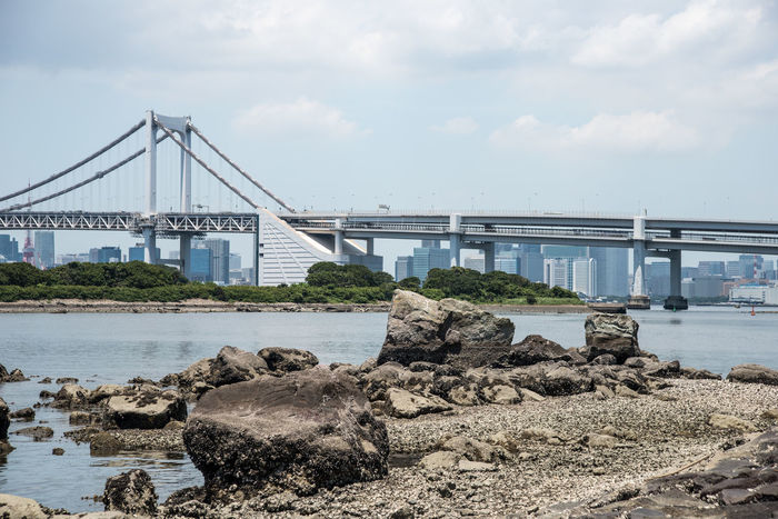 Tokyo Bay Architecture Bay Bridge Bridge - Man Made Structure Built Structure City Cloud - Sky Connection Day Engineering Minatoku Nature No People Odaiba Outdoors Rainbow Bridge Rock - Object Sky Suspension Bridge Transportation Travel Destinations Water