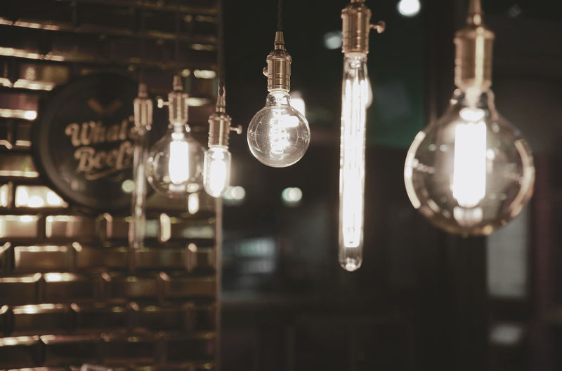 Light Stings hanging hard around Architecture Arrangement Bright Close-up Collection Dark Decoration Electric Lamp Electricity  Focus On Foreground Glass Glow Glowing Hanging Illuminated In A Row Indoors  Interior Interior Design Lamp Lightbulb Night No People Nobody Shine