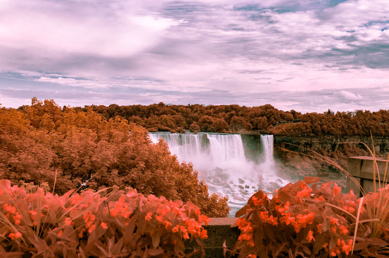 Scenic View Of Niagara Falls Against Cloudy Sky During Sunset