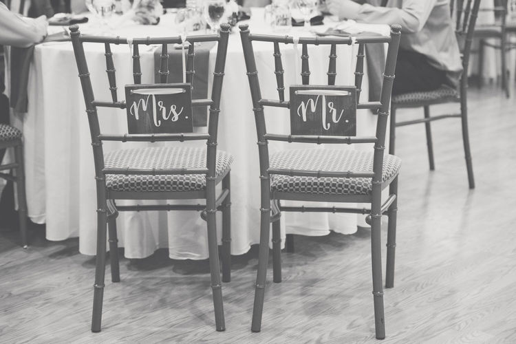 Wooden Chairs for a Newly Wedded Bride and Groom at their Wedding Reception Groom Husband Mr Reception Rustic Wedding Bride Chair Marriage  Mrs Newlywed No People Seat Water Wife Wood Chips Wooden