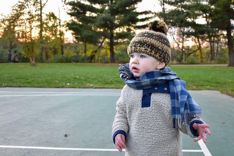 Cute boy standing on basketball court