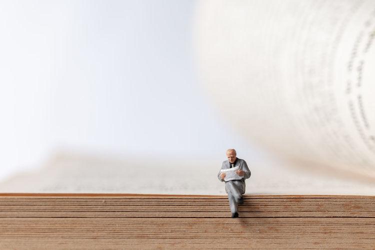 Portrait of man standing on wood