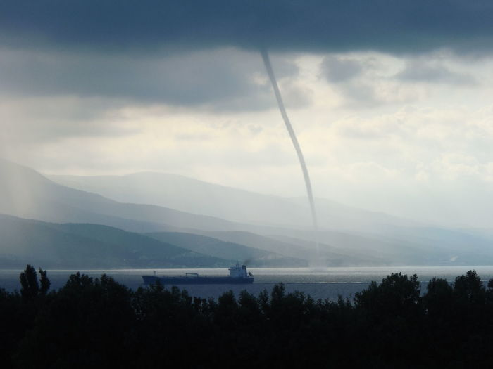 View Of Tornado In Lake Against Sky