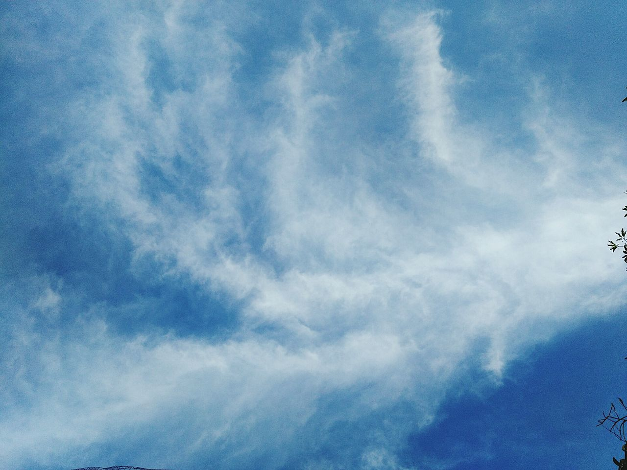 low angle view, sky, beauty in nature, blue, cloud - sky, nature, day, sky only, no people, scenics, outdoors, tranquility, backgrounds