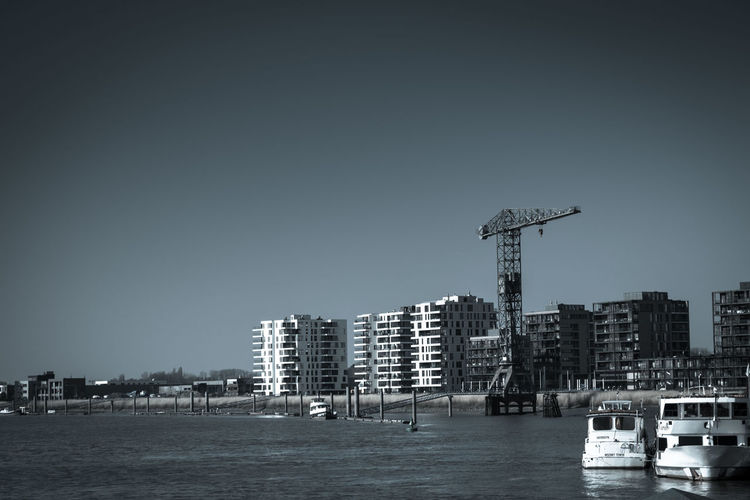 Architecture Building Exterior Built Structure City Cityscape Clear Sky Crane - Construction Machinery Urban Skyline Water Waterfront