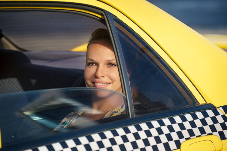Portrait of a smiling woman in car