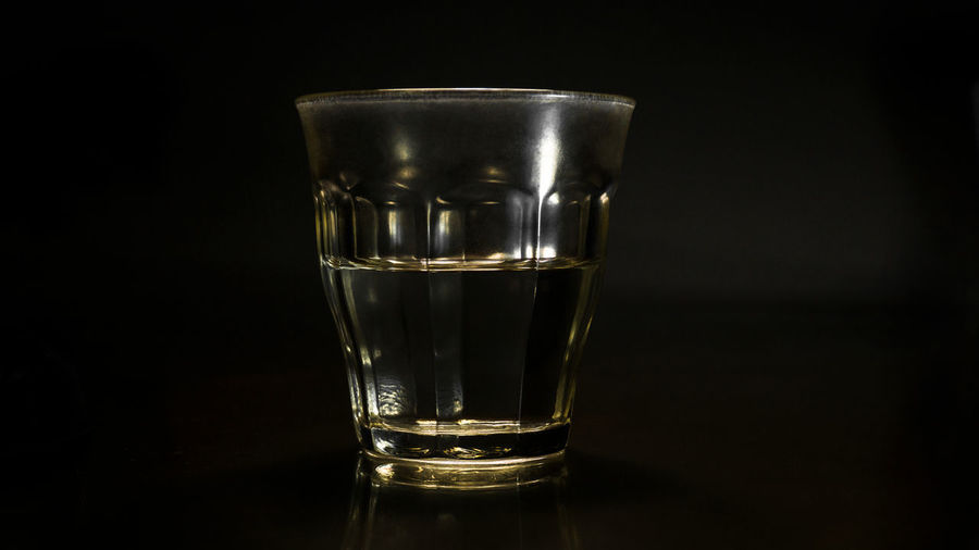 My mom's glass Antique Dark Light Objects Retro Black Background Blackandwhite Close-up darkness and light Drink Drinking Glass Food And Drink Glass Illuminated Indoors  Liqueur No People Shot Glass Studio Shot Vintage Water Visual Creativity The Still Life Photographer - 2018 EyeEm Awards