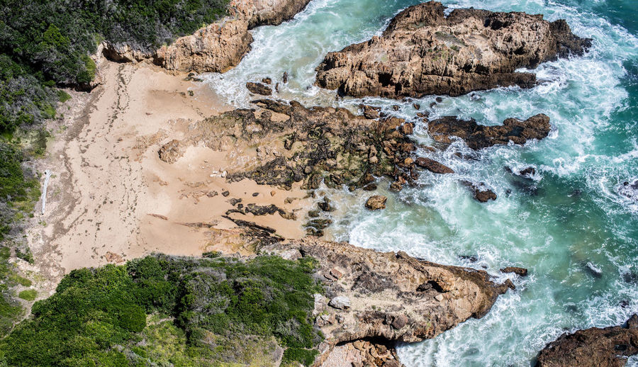 Beach Beauty In Nature Day High Angle View Land Motion Nature No People Non-urban Scene Outdoors Physical Geography Power In Nature Rock Rock - Object Rock Formation Scenics - Nature Sea Solid Tranquil Scene Tranquility Turquoise Colored Water