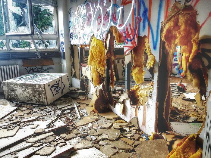 Graffiti on broken window of abandoned house