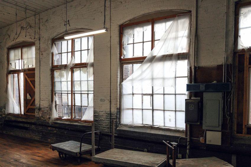 warehouse windows. Easthampton, Ma Massachusetts Windows Industrial Light And Shadow Sunlight Torn Carts Shining Through Showcase: April The Secret Spaces