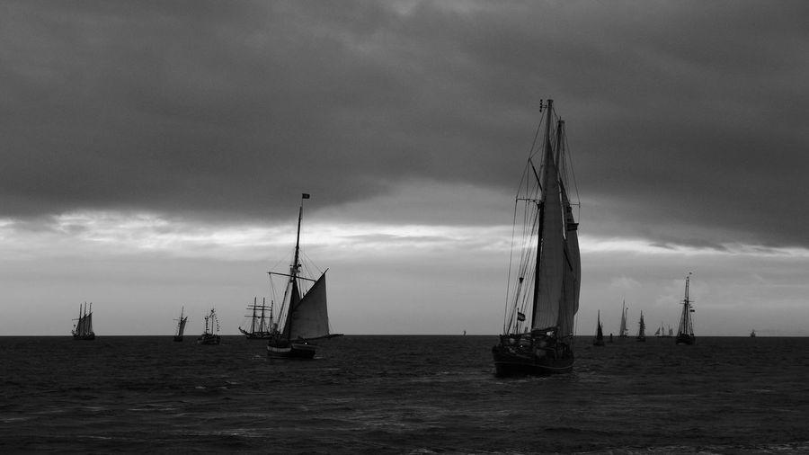 Silhouette of boats in calm sea