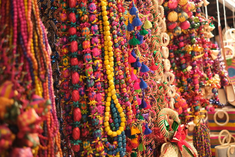 Close-up of multi colored for sale at market stall