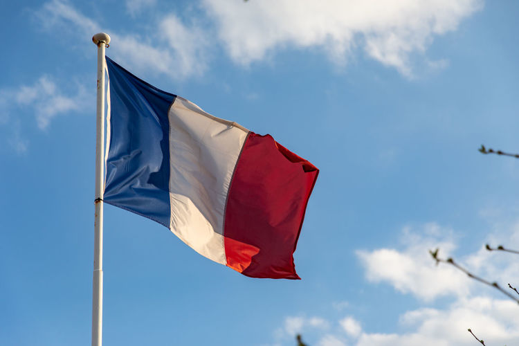French flag waving on the wind Wind Fluttering Retro Military Symbol Hanging Union National Pride Sunlight France Sky Holiday French Republic Waving White Cloudy Breeze Blue Curve Blowing Rippled Nation Francais Culture Europe Freedom Vintage Emblem  Concept Tricolor Power Francaise Government Success Majestic Red Independence LINE Pole Waving Flag Country Landmark Flag European  Unity Floating Travel