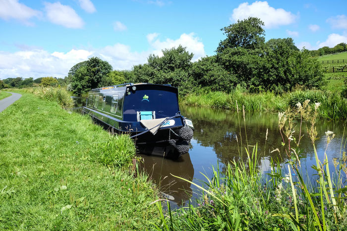 A barge moored on the Lancster canal England. Barge Barges Boat Canal Lancaster Landscape Long Boat Moored Rural Scenics Traditional Transportation Travel, Uk Waer Waterway