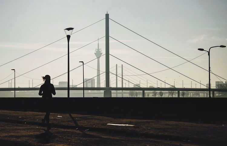 The City Light Lines Bridge Bridges Running Woman Full Length Sky Outdoors Real People One Person Cable Silhouette Connection Electricity Pylon Day Architecture Urban Urban Geometry Nikon D7000 The Graphic City