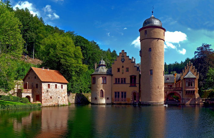 View of the Mespelbrunn Castle, a late medieval/early-Renaissance moated castle in the town of Mespelbrunn, Germany Architecture Building Exterior Built Structure Castle Day Germany Mespelbrunn Nature No People Outdoors Sky Tree Water Waterfront