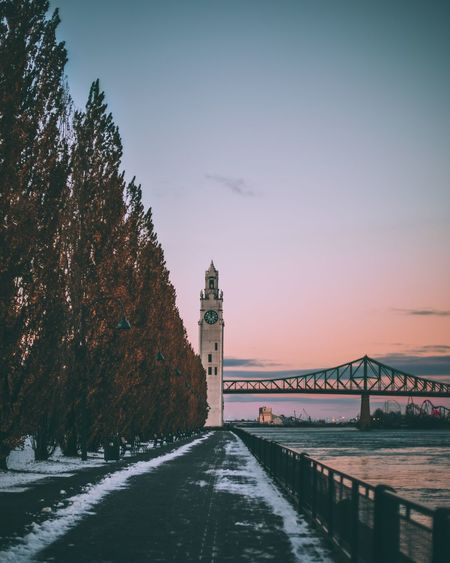 Sunset over the old port L4l Canon Moody Snowy Days... Oldport Sunset_collection Quebec Canada Montréal Architecture Built Structure Transportation Bridge - Man Made Structure Connection Travel Destinations Sky Outdoors Water River Winter Snow Cold Temperature Scenics Sunset Nature