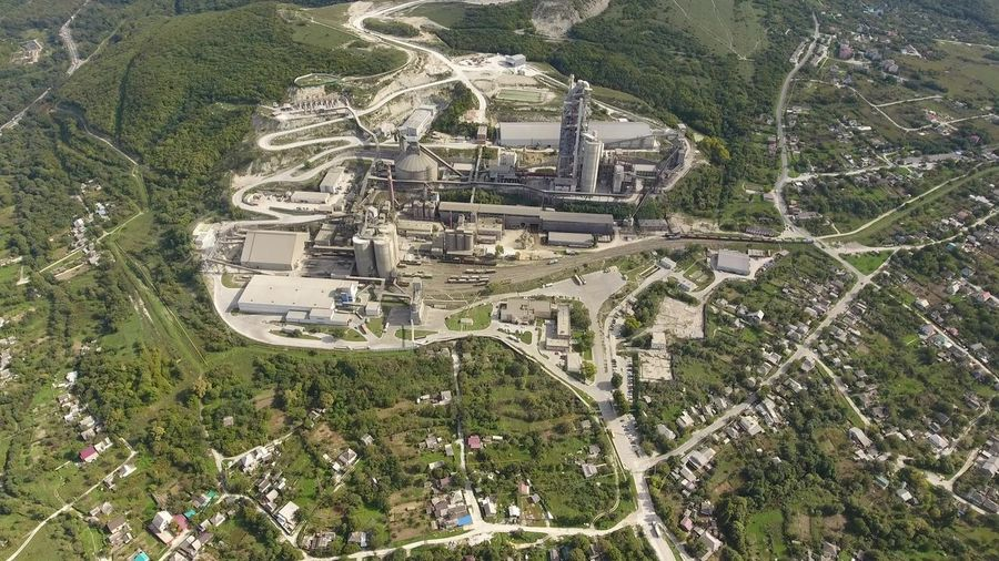Verkhnebakansky cement plant, top view. Factory for the production and preparation of building cement. Cement industry. Industry Plant Verkhnebakansky Cement Plant, Top View. Factory For The Production And Preparation Of Building Cement. Cement Industry. Cement Factory, Construction, Material, Concrete, Plant, Cement, Production, Site, Structure, Verkhnebakansky, Top View, Preparation, Building, Industry, Russia, Novorossiysk, Equipment, Industrial, Machine, Machinery, Promyshtennost, Manufacturing, Large, Pipes