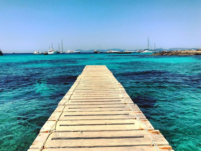 Sea Water Nautical Vessel Pier Day Transportation Jetty Blue Sailboat Tranquility Tranquil Scene Outdoors Clear Sky Scenics Beach No People Sky Nature Horizon Over Water Beauty In Nature