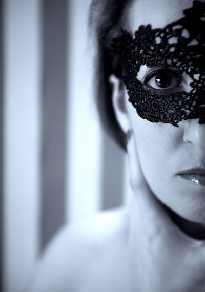 Close-up portrait of woman wearing eye mask at home