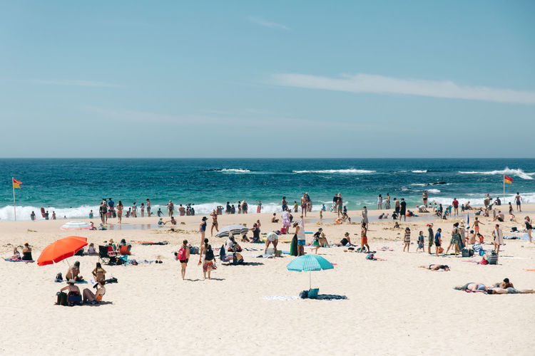 Sea Beach Water Crowd Large Group Of People Land Vacations Group Of People Trip Holiday Sand Sky Horizon Over Water Horizon Summer Leisure Activity Nature Relaxation Real People Outdoors Travel Destinations