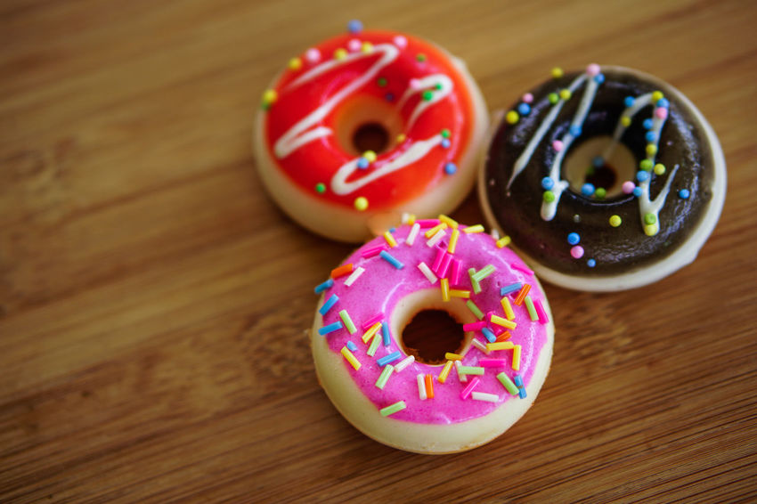 Sweet Food Food And Drink Food Donut Sweet Indulgence Multi Colored Indoors  Baked Wood - Material Table Sprinkles Unhealthy Eating Freshness Close-up No People Still Life Temptation Dessert Icing Snack Glazed Food