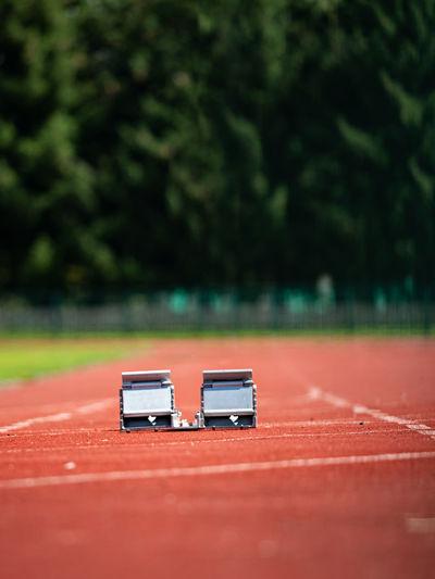 Starting blocks on the stadium treadmill in the summer