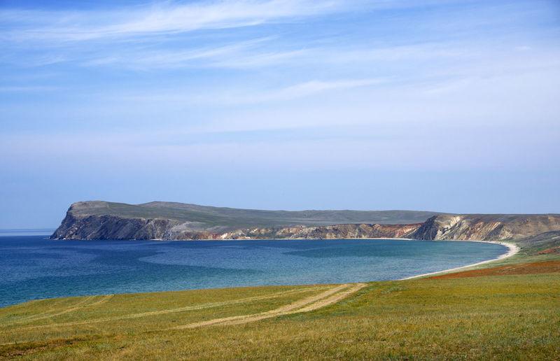Scenic view of kolkhoz island against sky
