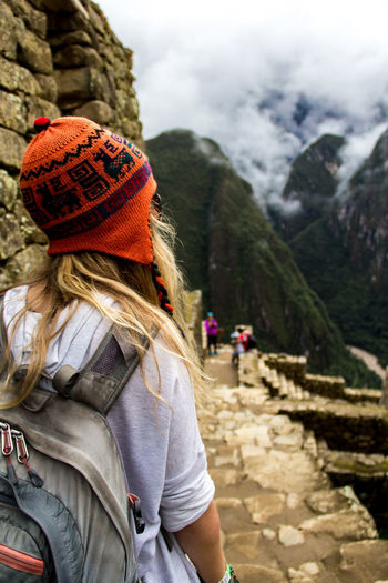 Rear view of woman looking at machu picchu during winter
