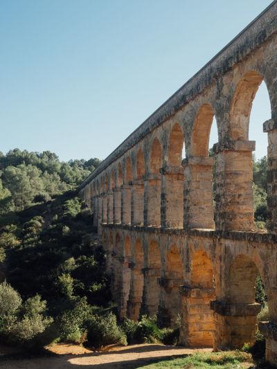 Aqueduct against clear sky