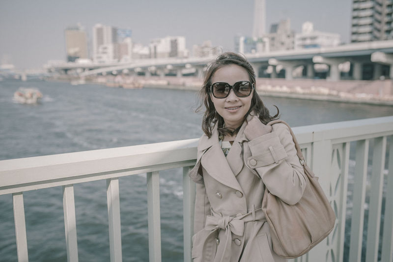 People Women Woman Portrait Working Japan Tokyo,Japan Portrait City Young Adult Glasses Architecture Railing Focus On Foreground Real People One Person Fashion Lifestyles Built Structure Standing Young Women Leisure Activity Building Exterior Sunglasses Smiling Waist Up Beautiful Woman Hairstyle Outdoors