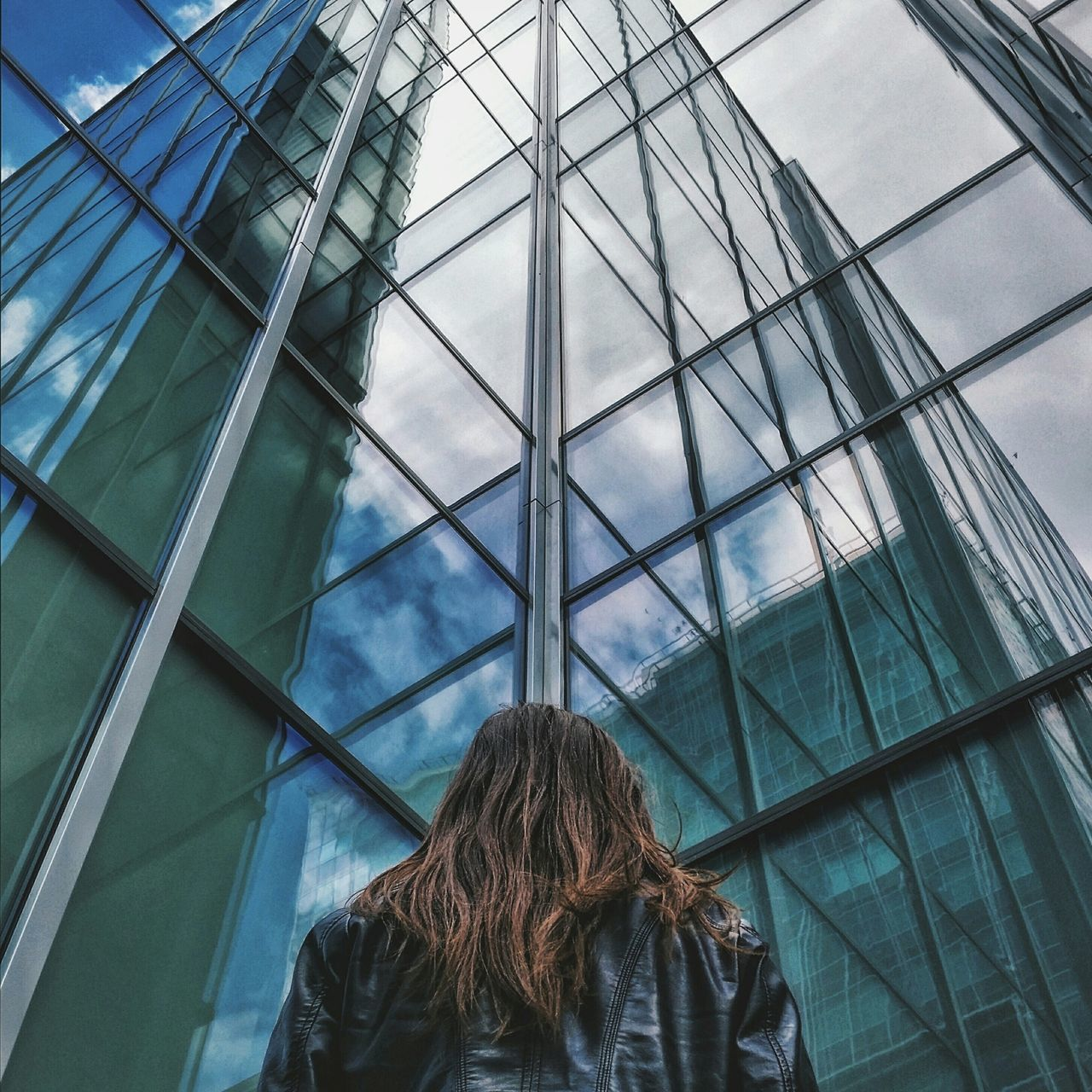 Woman in front of office building