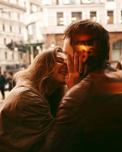 Togetherness Person Young Adult Overnight Success Young Women Leisure Activity Bonding Focus On Foreground Architecture Love Headshot City Casual Clothing Building Exterior Blond Hair Long Hair Holding Outdoors Day Inspirational Atmosphere Europe Traveling Home For The Holidays