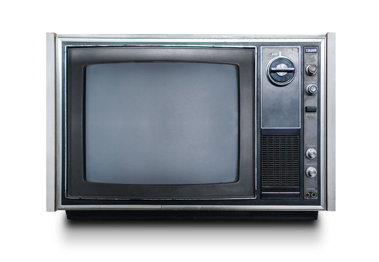 Close-up of vintage television on white background