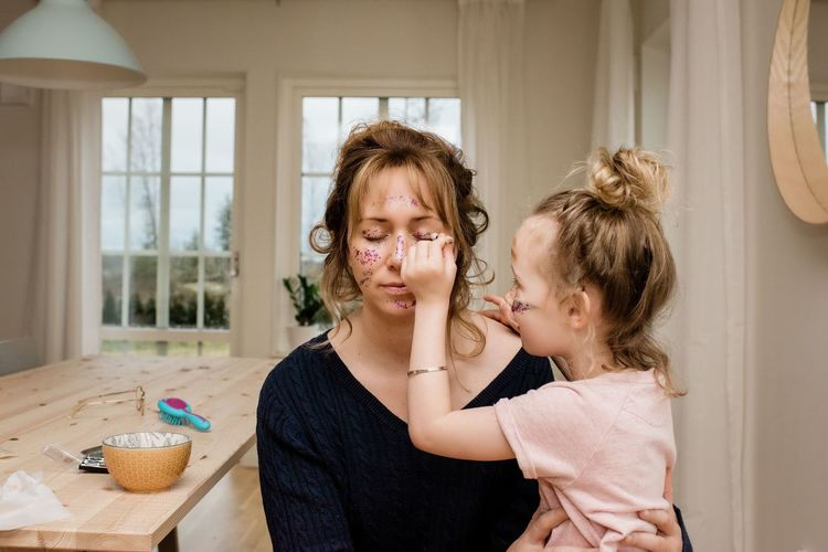 Portrait of mother and girl at home