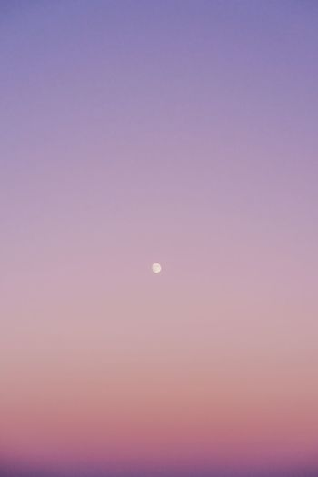 Scenic view of moon against sky at sunset