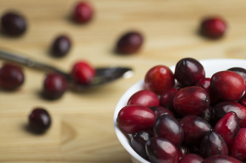 Close-up of cranberries on table