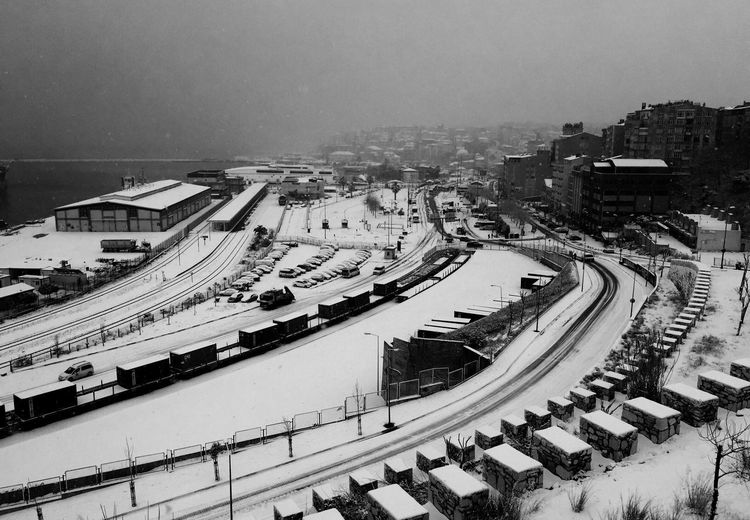 High Angle View Of Snow Covered Roads In City