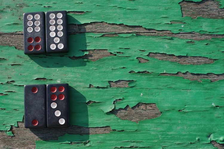 Dominos on old green wooden table