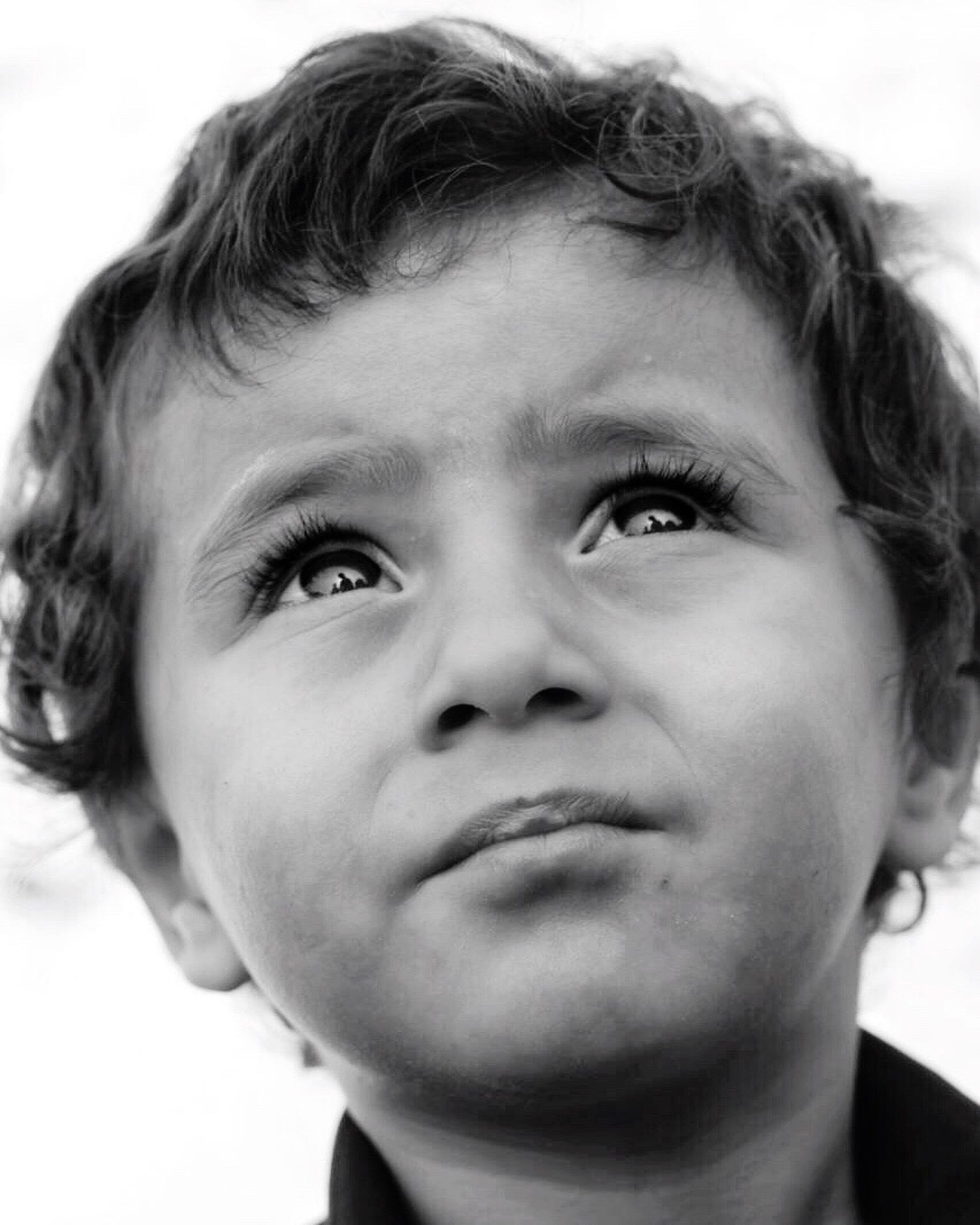 childhood, looking at camera, portrait, human face, child, one person, white background, close-up, front view, real people, headshot, human body part, children only, people, human eye, day, outdoors