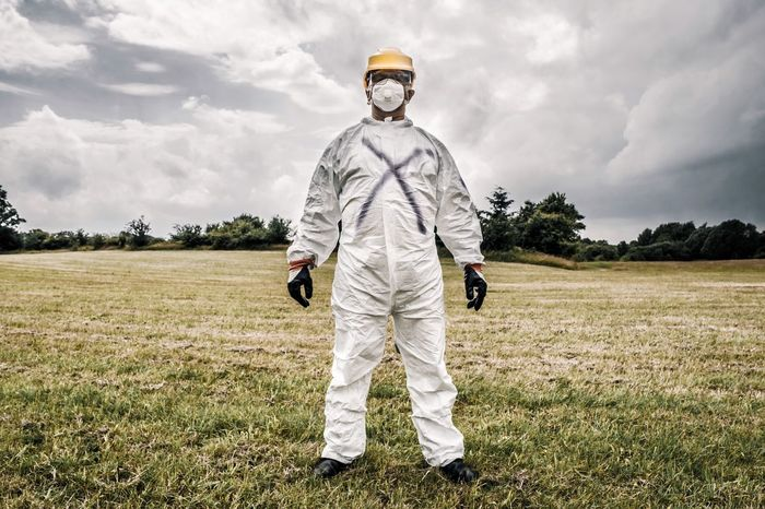 Man in a protective suit and a mask Spooky Wear Nuclear WorkWear Protective EyeEm Selects Field Cloud - Sky Grass Standing Landscape Full Length Sky Day Men Outdoors One Person Looking At Camera One Man Only Nature Only Men People