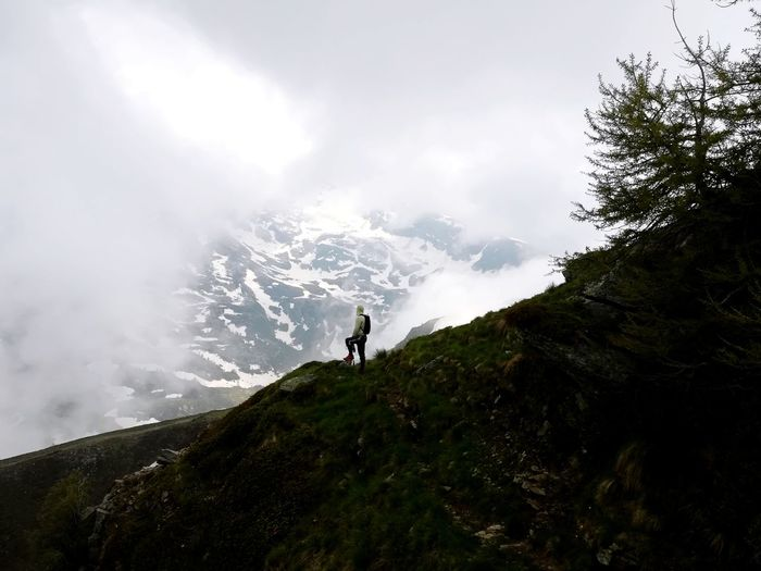 Explore. Mountain Full Length Adventure Motion Standing Hiking Sports Clothing Tree Politics And Government Summer Hiker Mountain Peak Cliff Steep Rock Face Mountain Climbing Glacial Mountain Range