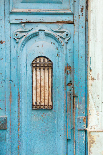 Closed blue door of old building