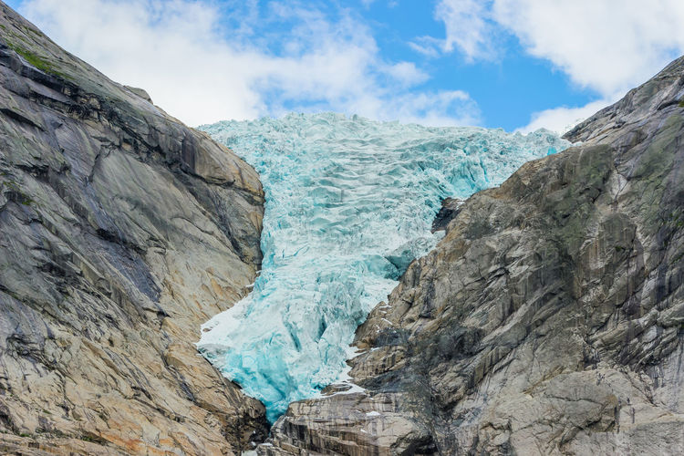 Low angle view of glacier against sky